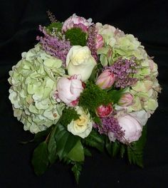 Springtime in a vase... Hydrangea, peonies, heather, tulips and so much more! See our entire selection at www.starflor.com.  To purchase any of our floral selections, as gifts or décor, please call us at 800.520.8999 or visit our e-commerce portal at www.Starbrightnyc.com. This composition of flowers is generally available for same day delivery in New York City (NYC).