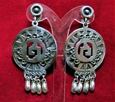Mid Century sterling silver boho earrings Round embellished pendant with 4 dangling drops Signed BSP, Cuernavaca, pre eagle Signed Hecho en Mexico 925, has tested positively for sterling Screw back style 2 1/4 inch x 1 1/8 inches Very good vintage condition International buyers welcome, I offer 13$ flat rate jewelry shipping, over charges are automatically refunded Priority shipping is offered 32217  Credit Cards or Paypal accepted.