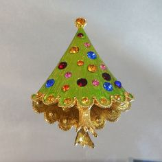 #Vintage Christmas Tree Brooch.  Lime Green.  Red Pink Blue Yellow Rhinestones.  Holiday.. $21.99, via Etsy. Have this of Mamaw Ruth's