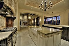 Luxury kitchen with large island and stone accents.  #kitchens #luxury homechanneltv.com