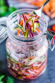 Quick Fridge Pickled Vegetables make the ultimate topping for tacos, burgers, and more! Featuring a blend of carrots, cucumber, radish, and onion, this healthy recipe is fast and flavorful!