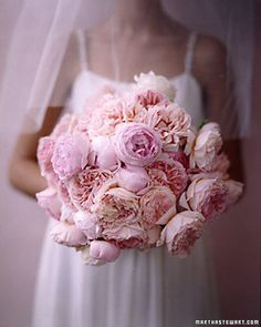 A bundle of pale pink and peach peonies make a striking bouquet.