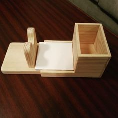Hot glue gun holder and organizer. The gun rests on the wooden holder with a tile to catch any glue. The tile is removable for easy cleaning and the box is the perfect size for extra glue sticks.