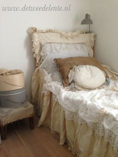 Pretty bed layered in vintage lace