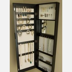 Fab.com | Door Jewelry Armoire   Front is a mirror, so you have a full length mirror in your room too!  Totally a DIY project.  Can you see it in barnwood?