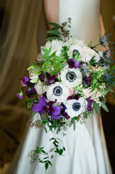 Cascading Bridal Bouquets with anemonas | ... Cascade Bouquet Anemones Thistle Waterworks Outside Wedding Sweetpeas