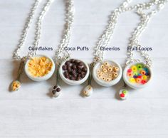 A cute kawaii cereals in a bowl necklace made from polymer clay -1 bowl filled with cereals spoon and milk. Choose your flavor: cheerios fruit loops