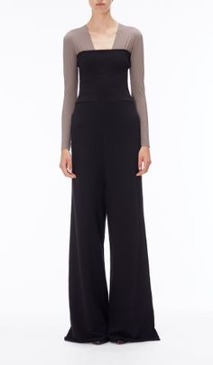 Vetements Black Trouser Jumpsuit. The billowing wide leg on VETEMENTS 1ST SEASON voluminous trousers adds drama to this standout style. This is an investment piece and can be either worn styled with the jersey waistband unrolled, or worn as a jumpsuit.