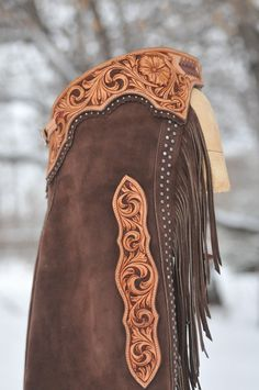 Tooled and dyed yokes, leg shields. double spots down leg and around yoke. Dark brown split leather.