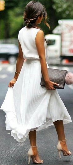 *pleated skirt* Nothing screams summer like a white, midi pleated skirt! Go to www.1robepour1soir.com for similar styles!