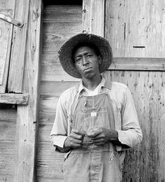 A Black male in the depression. Black People were usually poorer and treated badly during the depression along with that they usually had to live in a separate area of towns and paid lower wages.