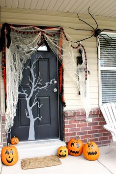 cool front door halloween decor with webs and spiders - Halloween Front Doors