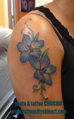 Blue Flower Larkspur Woman's tattoo by Chucho. Tattoo City Skin Art, Lockport, IL. www.tattoocityskinart.com