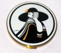 Vintage Stratton Dress Lady Enamel Compact    This art deco pancake shaped compact is from Stratton. Features a very stylish lady.