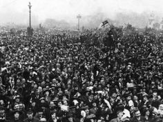 Thousands of people converge on Buckingham Palace in London while celebrating the end of the first world war on 11 November 1918