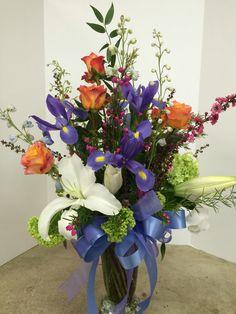 Purple iris in vase arrangement by Cyndy Smith