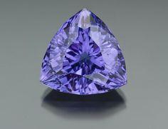 This 38.05-carat unheated lilac tourmaline resembles a fine tanzanite. - Courtesy Mayer & Watt. GIA (101414)