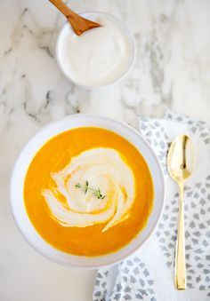 Carrot ginger soup on marble.