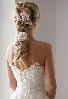 STUNNING! Totes having flowers in my hair for my wedding. Too bad I don't have half as much hair as she does...