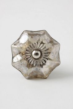 Anthropologie mercury drawer pulls. Nice alternative to the standard vintage glass pulls.