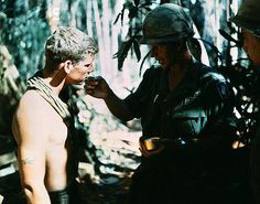 23 Nov 1967, Hill 875, South Vietnam --- An Army chaplain administers Holy Communion to member of 173rd airborne brigade prior to final assault on Hill 875, located 15 miles southwest of Dak To. --- Image by © Bettmann/CORBIS