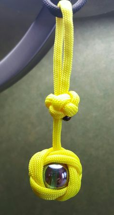 Paracord keychain Celtic button knot over marble.