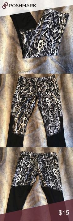 Leopard print yoga capris Black with 'snow leopard' print at the top, capris, yoga/workout pants. There is a key pocket, shown in the photo with the heart. NWOT brand is 90 degrees by reflex. Pants
