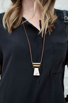Sister Golden | Magnesite Pendant Necklace –Long necklaces are a favorite for fall (and all year long)! This Magnesite Pendant stunner features a unique geometric white magnesite stone with brass tube det