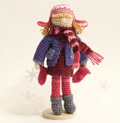 Handmade collectable doll. Magenta/ raspberry-red/ blue clothes
