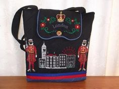 Sew a beautiful handbag in black linen, with red and blue tape and blue spot trim. London Town with Beefeaters and royal crown on the flap give this bag a special touch. Machine Embroidery Projects, Embroidery Supplies, Custom Embroidery, Embroidery Thread, Cross Stitch Embroidery, Embroidery Ideas, Beautiful Handbags, Beautiful Bags, London Bags