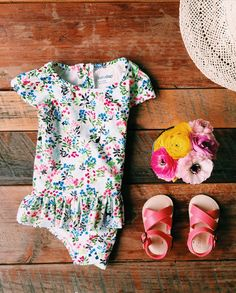 take a dip in petite floral print swimsuits and pair it with coral criss-cross sandals for an easy beachside look. give first swim favorites from babyGap for their special summer moments. #littlefirsts