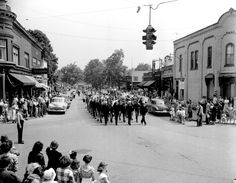 Photograph of soldiers and sailors marching south on Main Street as part of the Memorial Day Parade, 1950.