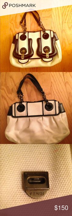 Fendi handbag What gem! This creamy canvas + black patent leather Fendi hand bag is gorgeous. This bag is 10+ years old and has been well taken care of! It shows only slight signs of wear and tear. Fendi Bags