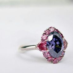 Scott West The impossibly rare Argyle Violet diamond set in a gorgeous one of a kind ring setting surrounded by rare vivid argyle pink diamonds. A true masterpiece design by Scott West. Pink Diamond Ring, Sapphire Diamond Engagement, Champagne Diamond, Purple Jewelry, I Love Jewelry, Fine Jewelry, Argyle Pink Diamonds, Colored Diamonds, Rare Gems