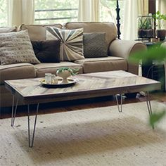 Instructions for how to make your own herringbone coffee table! (via wit & whistle)