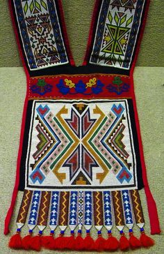 Native American Beadwork, by Maia C. 1860 ca  Artist was of the Iowa (Mesquakie) tribe. This is made of nettle twine, trimmed in wool, beads and deerhide.             Flickr - Photo Sharing!
