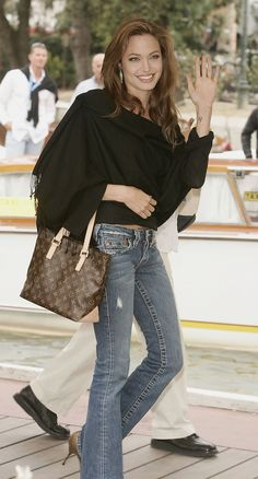 It's surprising to see Angelina in casual jeans.