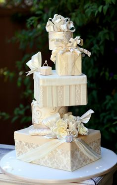 Boxes stacked one on top of each other!!this is such an amazing wedding cake!!