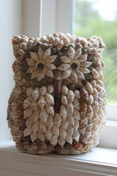 Item was sold on Etsy... just love the owl + shells/beachy. Eye candy! ... http://www.etsy.com/listing/72692903/vintage-shell-art-owl-made-in-the