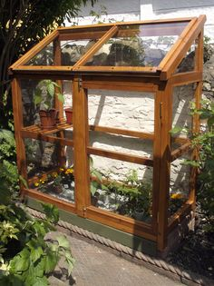 I designed this mini greenhouse for the bottom of the garden because we couldn't find any that would fit the depth of the border. The plants are thriving in there now.  (South Wales)