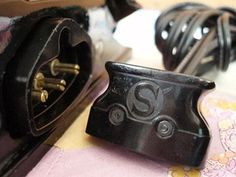 A common question we receive has to do with the Singer Featherweight 221 plug being too loose in the receptacle. Watch the short video for Hint to fix it. Sewing Machine Repair, Featherweight Sewing Machine, Stuck In The Middle, Electrical Cord, Electrical Connection, Vintage Sewing Machines, Plugs, Cuff Bracelets, Singer