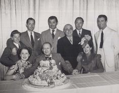 Mickey Rooney , Robert Montgomery, Clark Gable , Louis B. Mayer, William Powell, and Robert Taylor . Seated: Norma Shearer , Lionel Barrymore, Rosalind Russell. - 1939