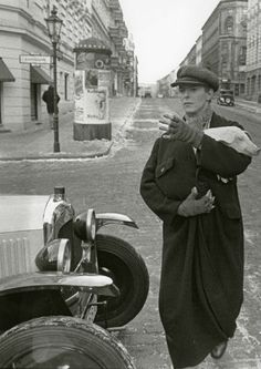 David Bowie cradling his little piggy friend through the streets of Berlin on the set of his 1979 film Just A Gigolo.  His bizarre role is that of a Prussian aristocrat that reports to the front approximately two minutes and forty-five seconds before the end of the WWI but struggles for two years to get back home in post-war Berlin where he eventually starts working as a gigolo. Upon his return he is chased by a hungry crowd of Berliners who are after the pig he has himself borrowed: Crowd…