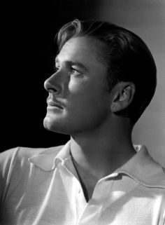 Errol Flynn - I can see why so many swooned (the sheer beauty of the good black and white portrait print)