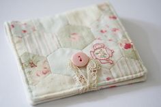 Hexies needlebook - check out the cute embroidery details on the hexie right above the button - so adorable!