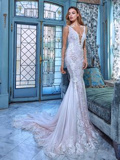 Daria is our special gown inspired by royal rose gardens. It has sharp edge details surrounding the body and they create a very statuesque silhouette. It has a deep plunging v-neckline on both front and back of the dress. The gown has sheer sleeves and organza side details that reach in outward directions. The front of the dress is hand-beaded with crystals and sequins.