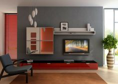 color blocking sorgt für eine farbexplosion im wohnzimmer: das ... - Wohnzimmer Ideen Rot Grau