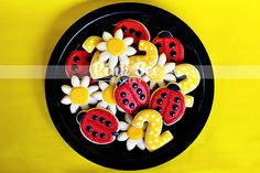 Ladybugs, daisies, the number 1, the letter A...all ideas!  Do assortment for the party, put on sticks as favors to take home.    Number could be yellow with white dots as shown here.  Letter could be red with black dots.