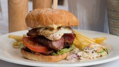 Black angus beef burger with bacon egg lettuce and tomato with chips and coleslaw on the side [OC] [5340x3024]