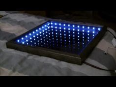 How to Make an Infinity Mirror. An infinity mirror is an optical illusion that you can put up in your home as a fun and interesting décor item. It's made in a shadowbox frame with a mirror in the back, some LED lights around the middle, . Mirror Box, Led Mirror, Wall Mirrors, Mirror Ideas, Led Diy, Infinity Spiegel, Led Infinity Mirror, Mirror Illusion, Cool Illusions